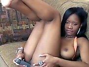 Cute coed Mercy Starr stuffs her ebony pussy with a dildo