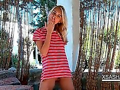 Teenage sex siren Sasha teasing her wet pussy