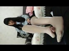 Oriental teen footjob