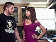 Cougar mama blows young cock in the kitchen