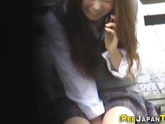 Asian student rubs clit