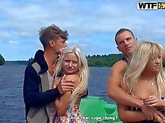 blondes and their boyfriend on the beach