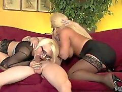 Horny mom and her busty daughter pleasuring cock