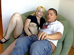 Cigarette smoking blonde girl in short skirt gives blowjob and gets fucked