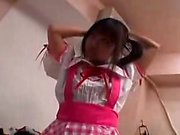 Adorable Oriental teen with pigtails sensually reveals her