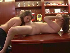 Sexy brunette sits on a chair so her girlfriend can lick her fuckhole