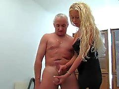 Busty blonde gives older guy a handjob
