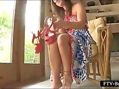 Teenage busty babe fucks her cunt with a shoe heel
