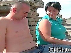 Chubby granny sucking dick outdoors