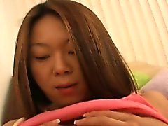Cute Asian teen pours oil on her panties