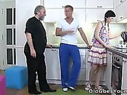 Karina kneels before both of her men and takes their cum