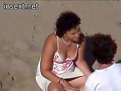 Teen couple caught at the beach