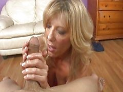 Handsome mature blonde plays with stiff young knob on bed