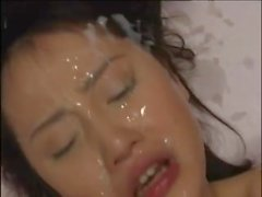 Japanese vixen takes a facial cumshot after having her hairy twat screwed