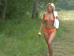 Beautiful blondie gets her ass fucked in forest