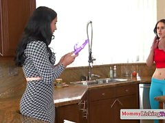 Stepmom pussylicking teen babe in kitchen