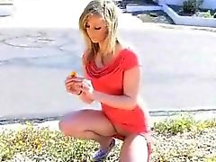 Blonde temptress talks a walk naked in public