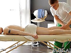 Attractive teenie sucks ramrod during massage