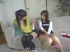 Asian girl masturbates on couch while young girl watches