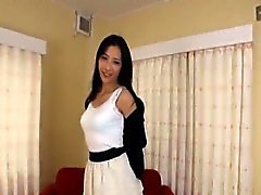 Slim and tall Japanese woman confidently strips naked Subs