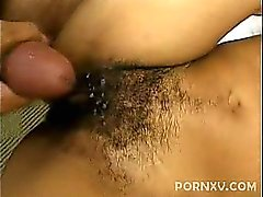 This pretty ebony pornstar greets her partner by showing off her bush covered muff. She spreads her black thighs wide and began playing with her cooze by buffing her clit with her digits and urged her partner to lend her his stiff meat and began swallowin