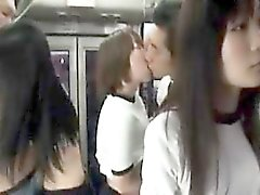 Naughty Asian teens in gym clothes fill their mouths with h