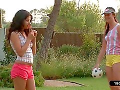 Two Young Lesbians Playing With a Ball in The Garden