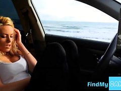 Blond beauty masturbates in the car