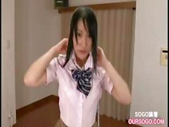 Skinny young college girl wearing a uniform masturbates using a dildo