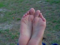 Teen showing soles in the Park